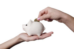Hands and moneybox Stock Photos