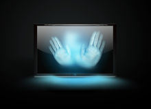 Hands in the monitor Royalty Free Stock Image