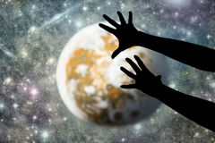 Hands and moon Stock Photography