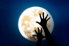 Hands and moon Royalty Free Stock Photos