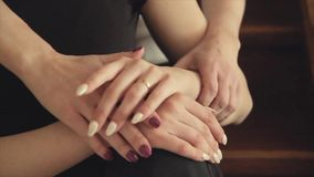 Hands of mother and adult daughter close-up. 1 stock video footage