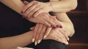 Hands of mother and adult daughter close-up. 1 stock footage