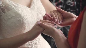 Hands of mother and adult daughter close-up. 1 stock video