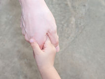 Hands of mother and child. Hands of a mother and a childs hands royalty free stock photos