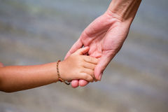 Hands of mother and child close up Royalty Free Stock Photos