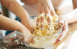 Hands of mother and child making dough royalty free stock images