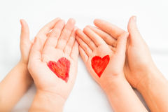 Hands of mother and child. With painted hearts Royalty Free Stock Photo