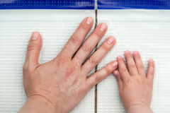 Hands of a mother and a child Stock Images