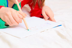 Hands of mother and child writing letters. Early education Royalty Free Stock Image