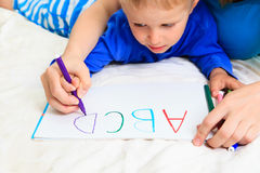 Hands of mother and child writing letters Stock Photography
