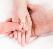 Hands of mother, father and baby stock photography