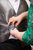 Hands of mother helping his son in his wedding day Royalty Free Stock Images
