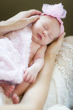 Hands of Mother Holding Her Newborn Baby Girl Stock Image