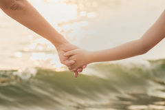 Hands of mother and son holding each other Royalty Free Stock Photography
