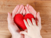 Hands of mother and son holding heart symbol Stock Image