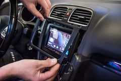 Hands mounting frame on touch display in car stock photos