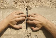 Hands move apart a wall. Hands move apart a cement wall royalty free stock photography