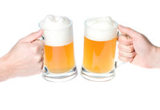 Hands with mug of beer cheers. Isolated on white Royalty Free Stock Photo