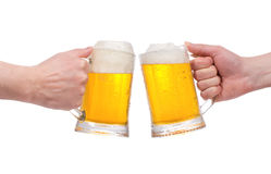 Hands with mugs of beer Royalty Free Stock Photos