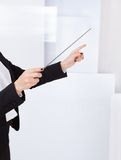 Hands of a music conductor with a baton Stock Image