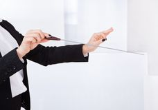Hands of a music conductor with a baton. Closeup of the hands of a music conductor with a baton with copyspace Stock Image