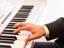Hands of musician close-up. Pianist playing on electric piano Royalty Free Stock Images