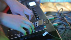 Hands of a musician, DJ working with a pocket operator, mixer. Close-up of the hands of a musician, DJ working with a pocket operator, mixer stock footage