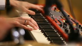 Hands of the musician on the keyboard of an Piano keyboard. Music instrument. Black and white key. Play sound, chord stock footage