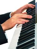 Hands of musician. Pianist playing on a synthesizer, isolated on Royalty Free Stock Image