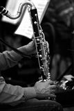 Hands musician playing bass clarinet. In black and white royalty free stock images