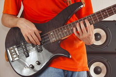 Hands of musician playing the bass guitar Royalty Free Stock Images