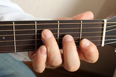 Hands of a musician playing classical acoustic guitar. Close-up. Chord Royalty Free Stock Photo