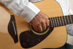 Hands of a musician playing classical acoustic guitar. Close-up Stock Photos