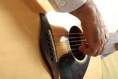 Hands of a musician playing classical acoustic guitar. Close-up Royalty Free Stock Image