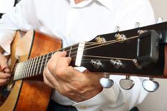 Hands of a musician playing classical acoustic guitar. Close-up Stock Photo