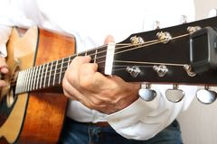 Hands of a musician playing classical acoustic guitar. Close-up Royalty Free Stock Photos