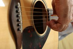 Hands of a musician playing classical acoustic guitar. Close-up Stock Photography
