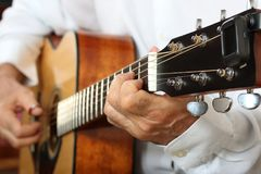 Hands of a musician playing classical acoustic guitar. Close-up. Chord Royalty Free Stock Images