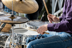 Hands of musician while playing drums during street concert Stock Images