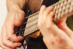 Hands of musician playing the electric bass guitar closeup Stock Photo