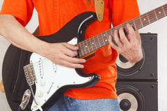 Hands of musician playing the guitar close up Royalty Free Stock Photography