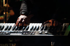 Hands of musician playing keyboard Royalty Free Stock Photo