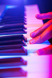 Hands of musician playing keyboard in concert with shallow depth Royalty Free Stock Photo