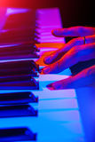Hands of musician playing keyboard in concert with shallow depth Stock Photography