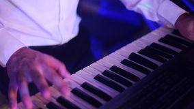 Hands of musician playing keyboard in concert stock video