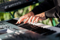 Playing piano. Hands of musician playing piano Stock Images