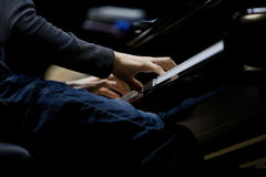 Hands musician playing the piano Royalty Free Stock Image