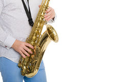 Hands musician playing the sax Royalty Free Stock Photography