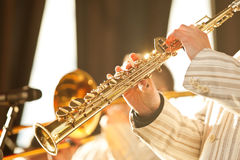 Hands of musician playing the soprano saxophone Royalty Free Stock Photo