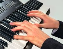 Hands of musician playing on a synthesizer, isolated on a white Stock Photo